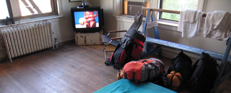 Room with TV, rucksacks, and view